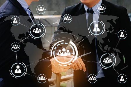 two business smart man talking and reading information about finance news in mobile phone with virtual innovation, network connection interface diagram, investment, technology, internet concept