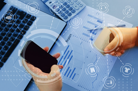 hand working with finances about cost and calculator, business strategy diagram report and mobile phone on desk at home office with graphic icon diagram, technology, plan money cost saving concept