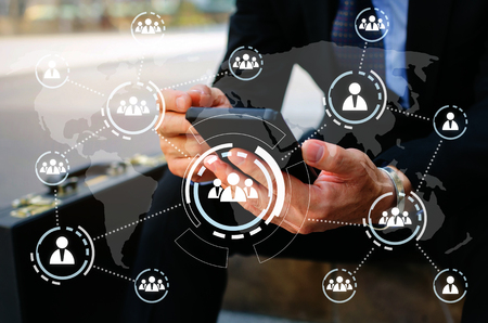 business man wearing modern black suit using mobile smart phone and briefcase with virtual innovation, network connection interface diagram, technology communication, internet and financial concept