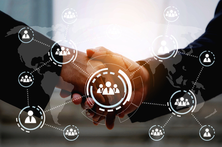 business man in suit handshake after finishing up a business meeting with virtual innovation, network connection interface diagram, congratulation, success, partner, teamwork and community concept