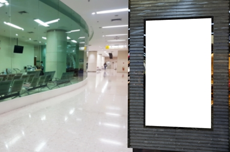 blank showcase billboard or advertising light box for your text message or media content with walk way in lobby at hospital background, commercial, marketing and advertisement concept Stock Photo