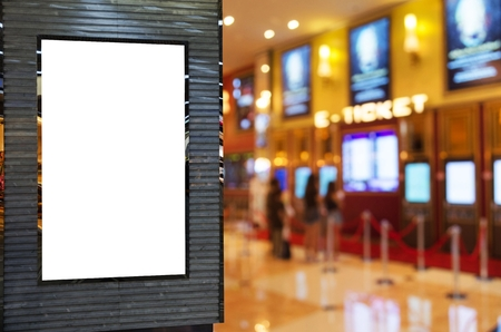 blank showcase billboard or advertising light box for your text message or media content with blurred image of ticket sales counter at movie theater, advertisement, marketing, entertainment concept Stock Photo