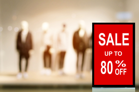 big sale 80% mock up advertise billboard or advertising light box with blurred image of popular fashion clothes shop showcase in department store, commercial, marketing and advertisement concept