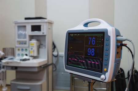 ECGEKG (Electrocardiography) monitor heart rate and oxygen levels at operating or emergency room in hospital Stock Photo
