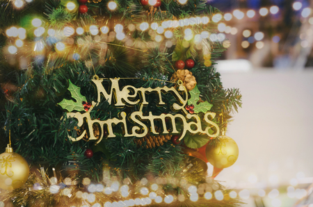 close up of christmas tree and bokeh light, christmas decorations for new years celebration, christmas holiday, new year holiday, festival concept, vintage color tone Stock Photo