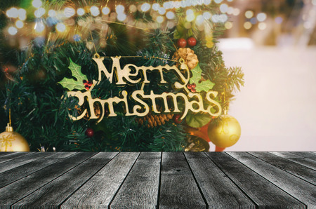 empty modern wooden terrace board or table with christmas tree and light in background, copy space for display of product or object presentation, celebration, christmas holiday, festival concept