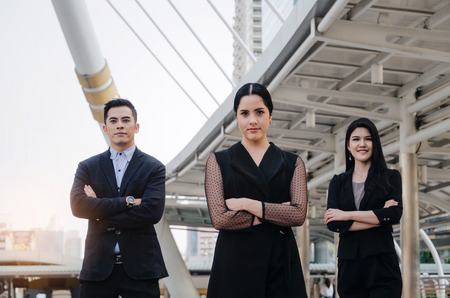 successful group of business people in modern black suit keeping arms crossed Stock Photo
