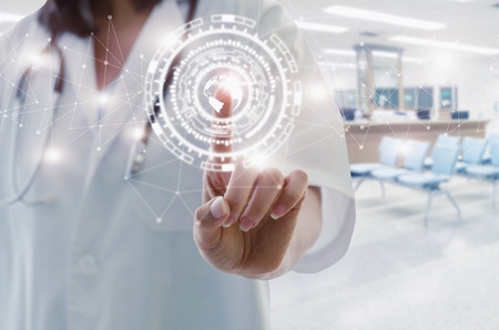 female doctor with stethoscope hand pointing touching world map data digital icon hologram with blurred image of lobby for waiting in hospital background, medical innovation, future technology concept