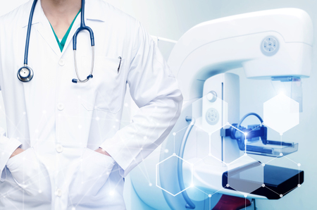 smart man doctor with stethoscope around his neck with technology digital network effect and Mammography X-Ray System Machine in hospital background, medical innovation, future technology concept
