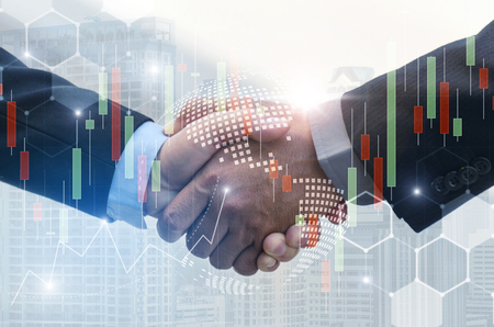 business man handshake with effect global world map network link connection and graph chart of stock market graphic diagram, digital technology, internet communication, teamwork, partnership concept Stock Photo