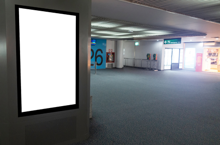 mock up of vertical blank advertising billboard or light box showcase with people waiting at airport, copy space for your text message or media content, advertisement, commercial and marketing concept