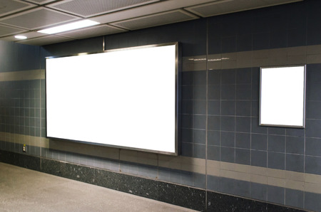 big blank advertising billboard on wall with copy space for your text message or media and content in subway train station or airport, information board, banner, marketing and advertising concept Stock Photo