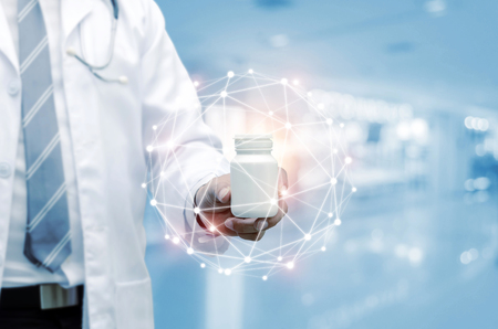 pharmacist doctor with stethoscope hand holding white medicine bottle with data digital network hologram in hospital background, health care pharmacy, medical innovation, future technology concept