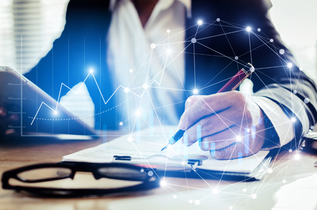 investor or accountant man using calculator for calculating and analysis financial report with graphic candle stick graph chart of stock market investment trading for Forex trading, marketing concept Stock Photo