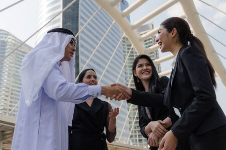 Deal. Welcome. group of Arabian business people handshake after finishing up new project plan business meeting in modern city, success, investment, partner, teamwork, community, connection concept