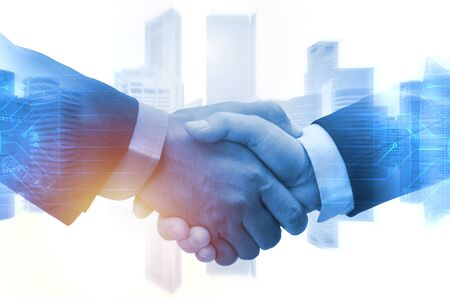 Deal. double exposure image of investor business man handshake with partner and graphic technology network daigram with during sunrise and cityscape background, investment and partnership concept