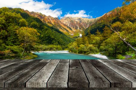 empty grey wooden table or wooden terrace with beautiful view of Kamikochi National Park in the Northern Japan Alps of Nagano, Matsumoto, Japan with Azusa river, landscape, travel and nature concept Фото со стока