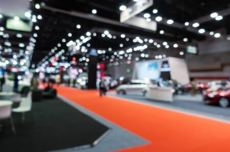 abstract blurred image of reception area from event hall at shopping mall or public event exhibition hall, international motor show exhibition, business convention show and business trade show concept