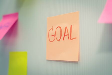Goal. Post It. many colored sheets sticky note paper on white board background in home office, business meeting, brainstorming, creative idea, digital online marketing and business financial concept