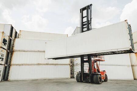 blank white shipping cargo container loading on forklift truck for transportation shipping and logistic at container cargo harbor, industrial, business logistics, import and export business concept