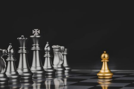 Employee. gold pawn chess with silver chess pawns pieces on chess board game competition on dark background, chess battle, success, management, team leader, teamwork and business strategy concept