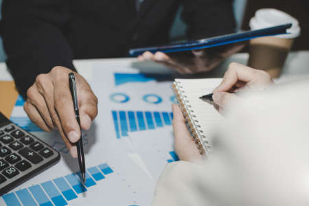 group business people meeting and planning about strategy finance business with document report on desk in meeting room office, partner, leadership, brainstorming, company meeting, financial concept