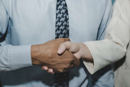 Partnership. two business man investor handshake deal with partner after finishing up business meeting in meeting room office, financial, teamwork, job interview, contract, partner, agreement concept
