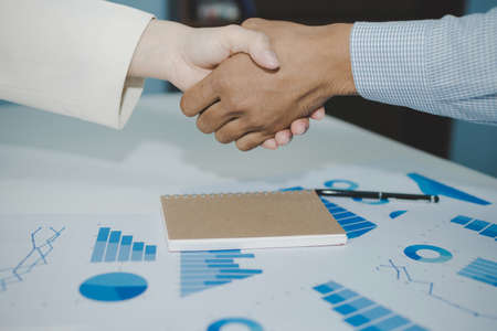 Partnership. two business people investor handshake deal with partner after finishing up business meeting on desk in meeting room office, financial, teamwork, job interview, contract agreement concept