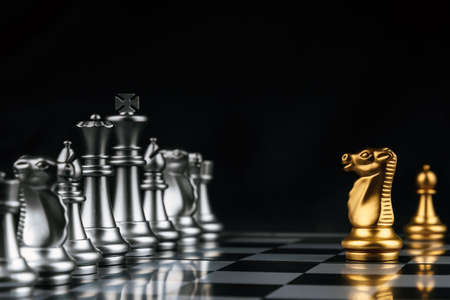 Leader.gold horse chess in front of silver chess pawns pieces on chess board game competition on dark background, chess battle, success, management, team leader, teamwork and business strategy concept