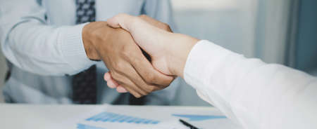 wide banner. Partnership. two business man investor handshake deal with partner after finishing up business meeting on desk in meeting room office, financial, teamwork, contract agreement concept