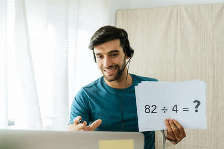 handsome man teacher working from home teaching online math subject to student studying from home