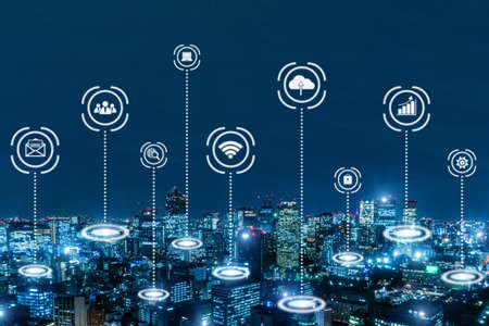 IOT (Internet of Things). global media link connecting on night city background, digital, internet, communication, networking, smart city, business, network connection and technology concept 版權商用圖片