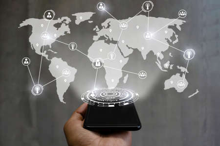 5G. smartphone on hand with global media link connecting on international world map background, digital, internet, communication, networking, business, network connection and technology concept 版權商用圖片