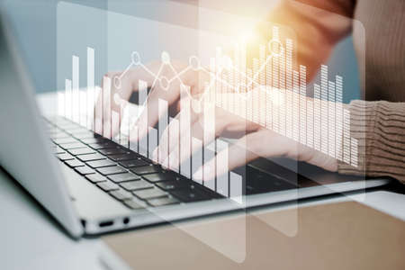business woman working on laptop computer on desk with graphic graph chart diagram, security technology, financial, stock market, online marketing, business strategy, finance and technology concept