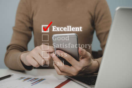 Feedback. woman hand checking mark on checklist box on digital mobile smart phone to review good performance, job interview, checklist planning, good experience, customer service and feedback concept