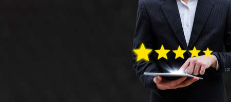 wide banner. 5 star rating. business man customer hand touching on mobile tablet with five star button to review good rating, digital marketing, good experience and customer feedback concept