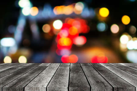 Table top. empty wooden board, table or modern wooden terrace with abstract night light bokeh at night festival in garden, background, copy space for display product presentation, vintage color tone Stock Photo