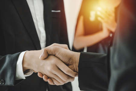 Partnership. business people group handshake and clapping hand after finishing up business meeting in office, congratulation on promotion, success, partner, teamwork, community, connection concept