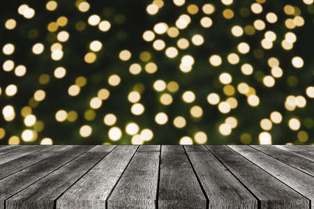empty wooden board, table or modern wooden terrace with abstract night light bokeh at night festival in garden, christmas background, copy space for display product presentation, vintage color tone