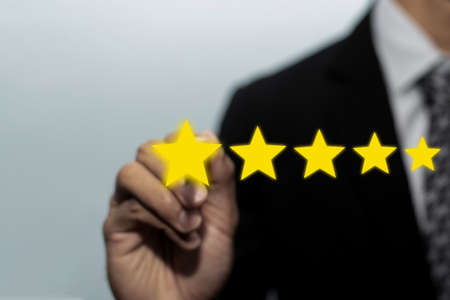 Five star rating. business man customer hand pointing on five star button to review good rating, digital marketing, good experience, customer product rating review and customer feedback concept