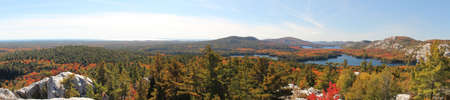 Panoramic view of the lakes, rocky hills and colourful forest at Killarney Provincial Park, Ontario, Canada  This photo is made attaching together various photos