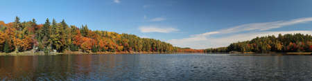 Panoramic photo of lake and autumn forest in Killarney Provincial Park, ON, Canada. This photo is made attaching together various photos Stock Photo - 16063549