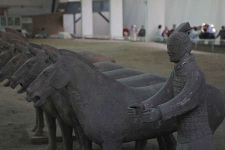 Horses and a soldier of Terracotta Army, in Mausoleum of the First Qin Emperor, an UNESCO world heritage site, in Xian, China