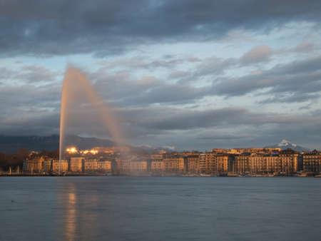 Geneva skyline with jet deau fountain on the lake in Geneva, Switzerland Editorial