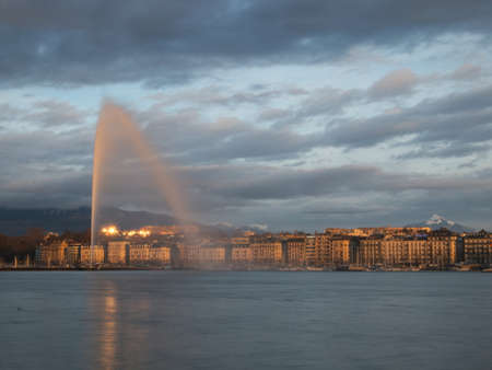 Geneva skyline with jet d'eau fountain on the lake in Geneva, Switzerland