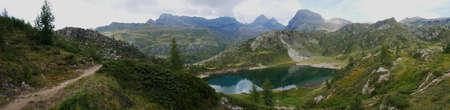 Small pure alpine lake on the Bergamo Alps, northern Italy Standard-Bild