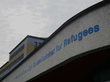 Sign at the main entrance of the UNHCR, the Office of the United Nations High Commissioner for Refugees, headquarters in Geneva, Switzerland Stock Photo - 85519149