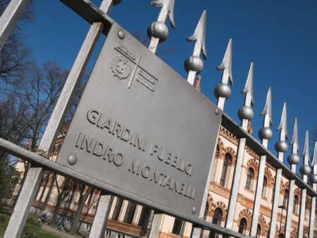 Public gardens Indro Montanelli entrance sign in Milan, Italy