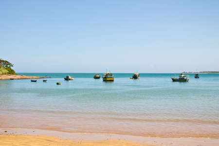 ocean fishing: Fishing boats on blue ocean view from the beach against blue sky Stock Photo