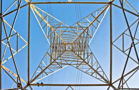 high section: high section of electric power line pylon against blue sky